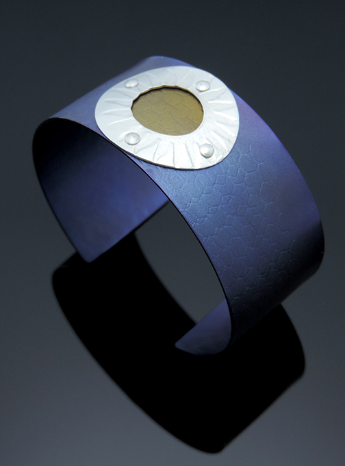 Power Punch Anodized Titanium Cuff